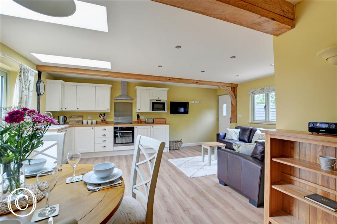 Open plan room with kitchen, dining and seating areas