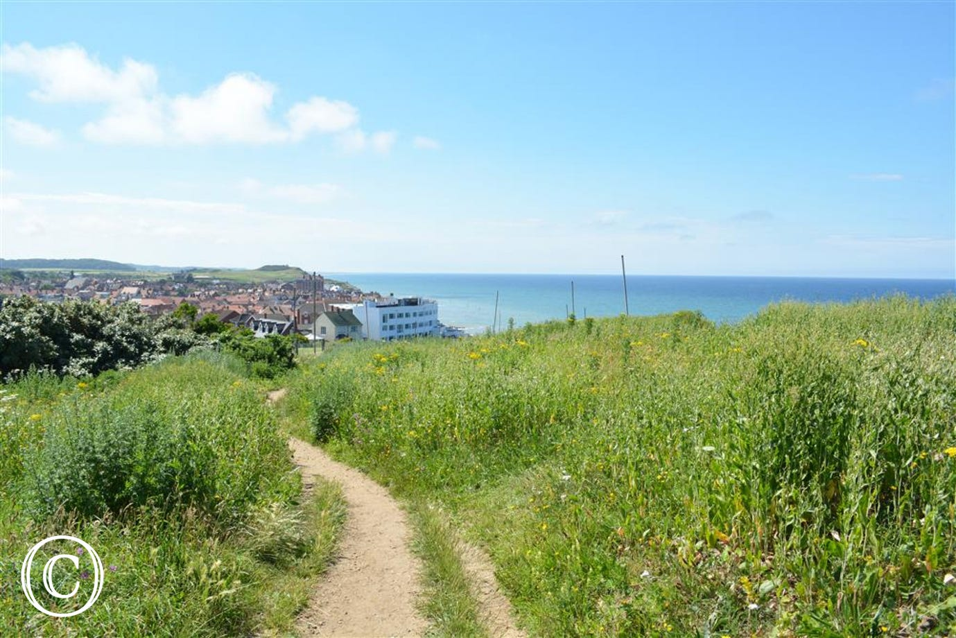 There is access to the coastal path from the rear garden