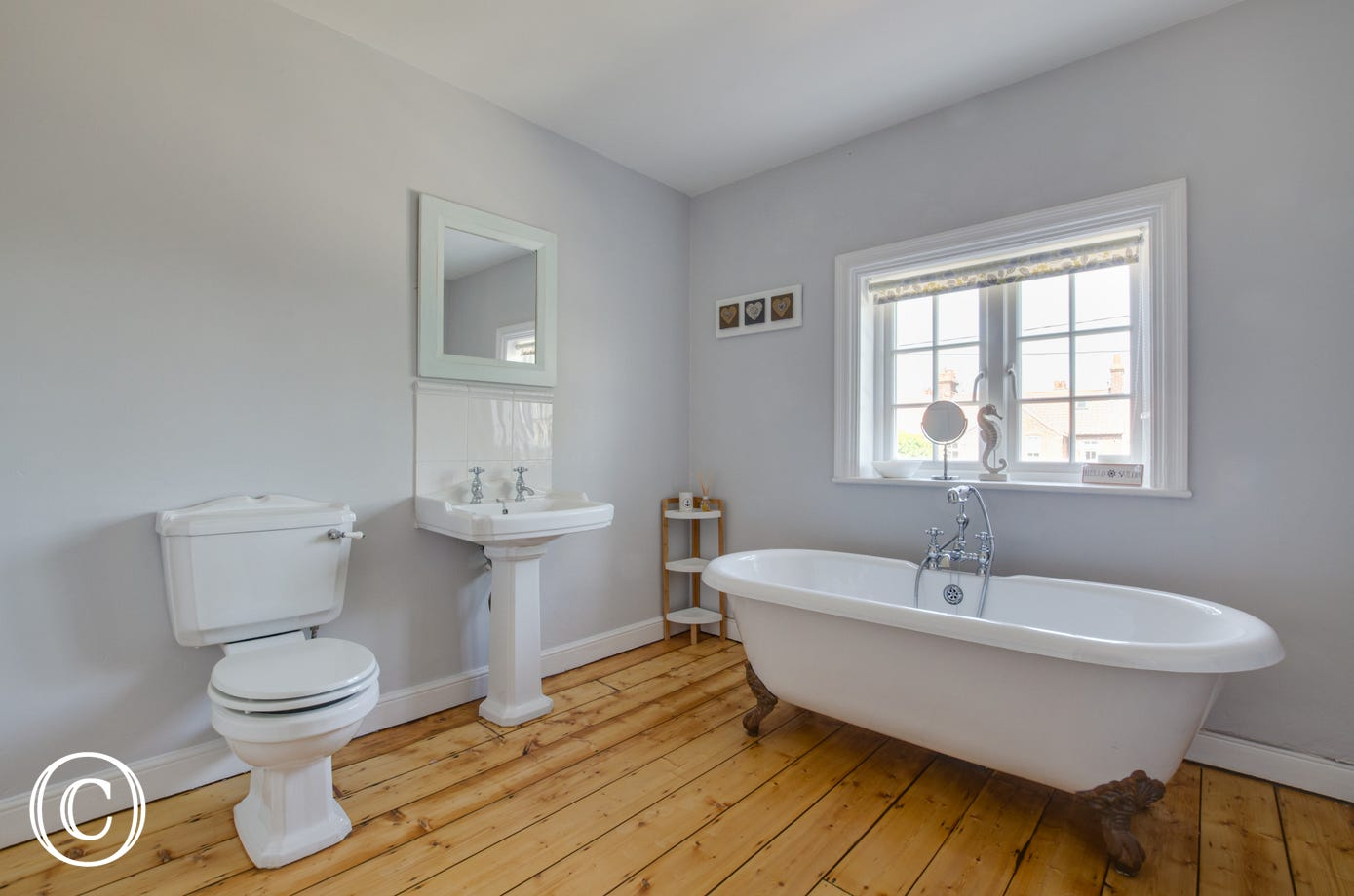 Family bathroom with free standing bath