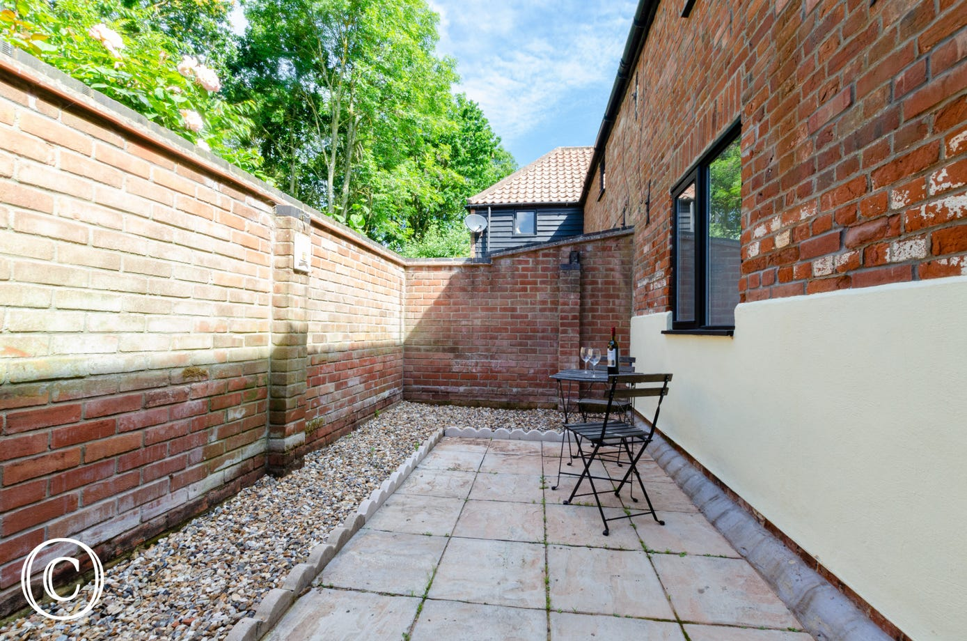 Enclosed patio area with garden furniture