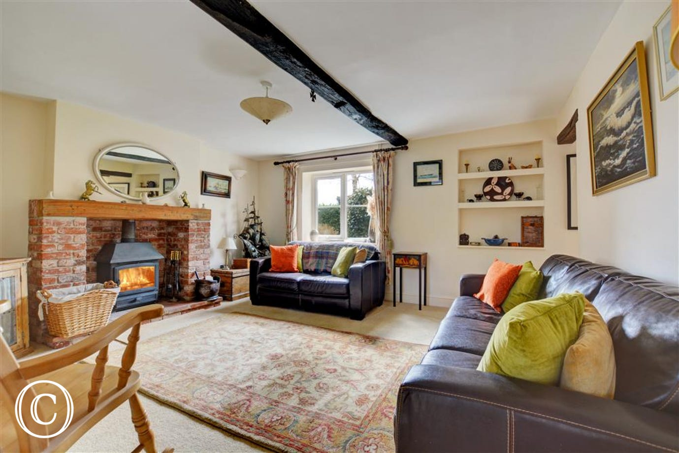 Lovely traditional sitting room with wood burner