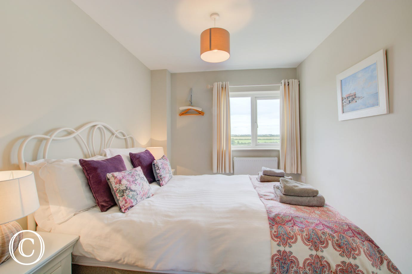 Bedroom four is a light and airy room with double bed