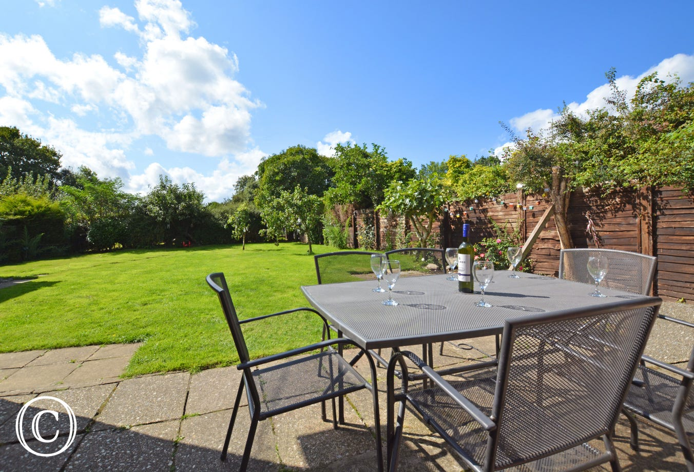 Patio with table and chairs - perfect for a spot of alfresco dining!