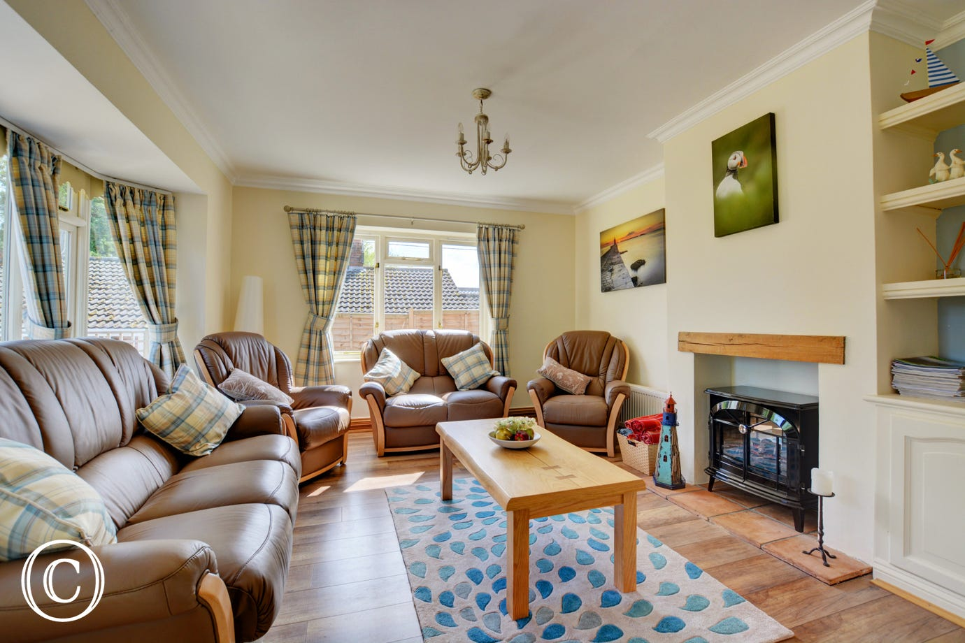 Light and welcoming Sitting Room with comfortable seating,  electric log burner, Smart TV, WiFi, DVD player and Docking station