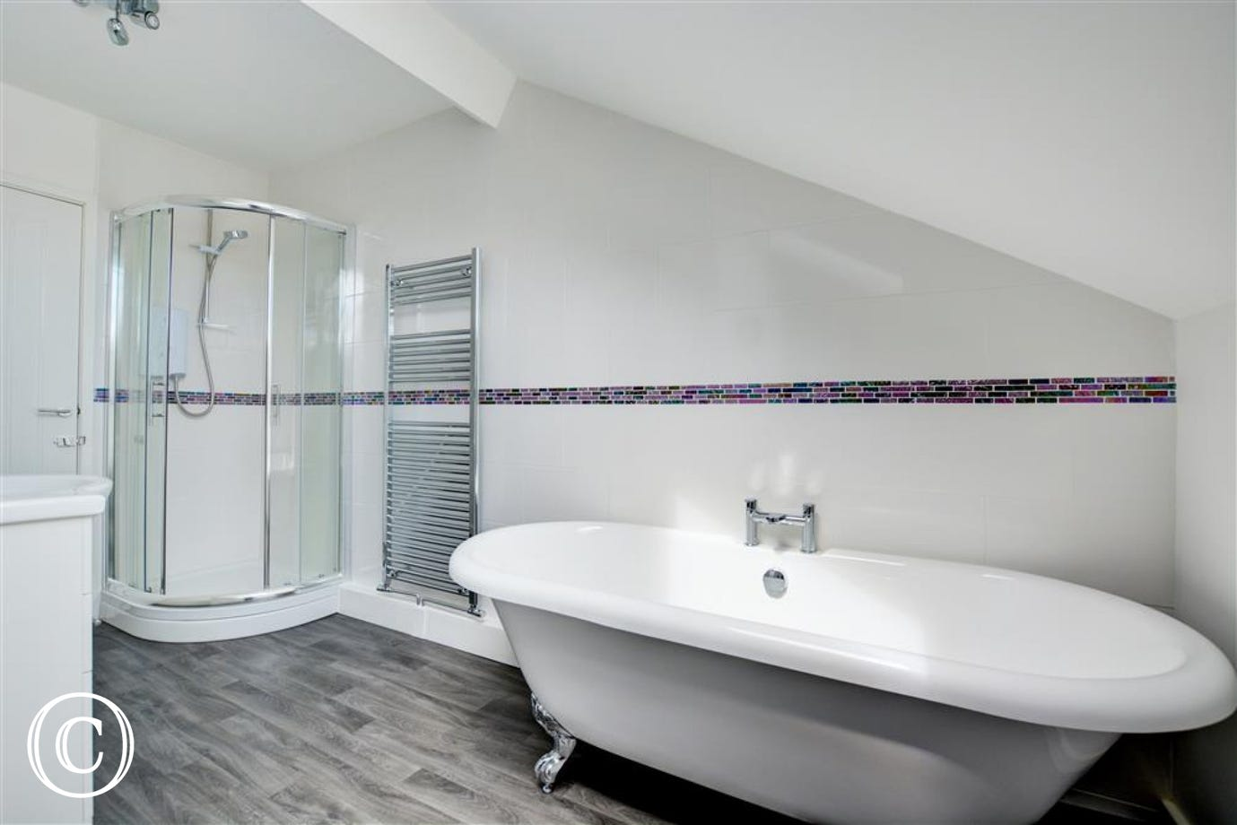 Bathroom with roll top bath and shower cubicle