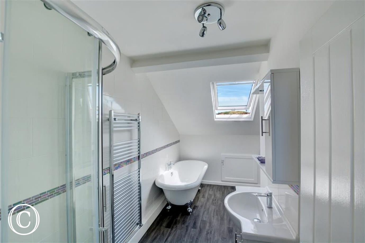 Modern tiled bathroom with bath and seperate shower cubicle
