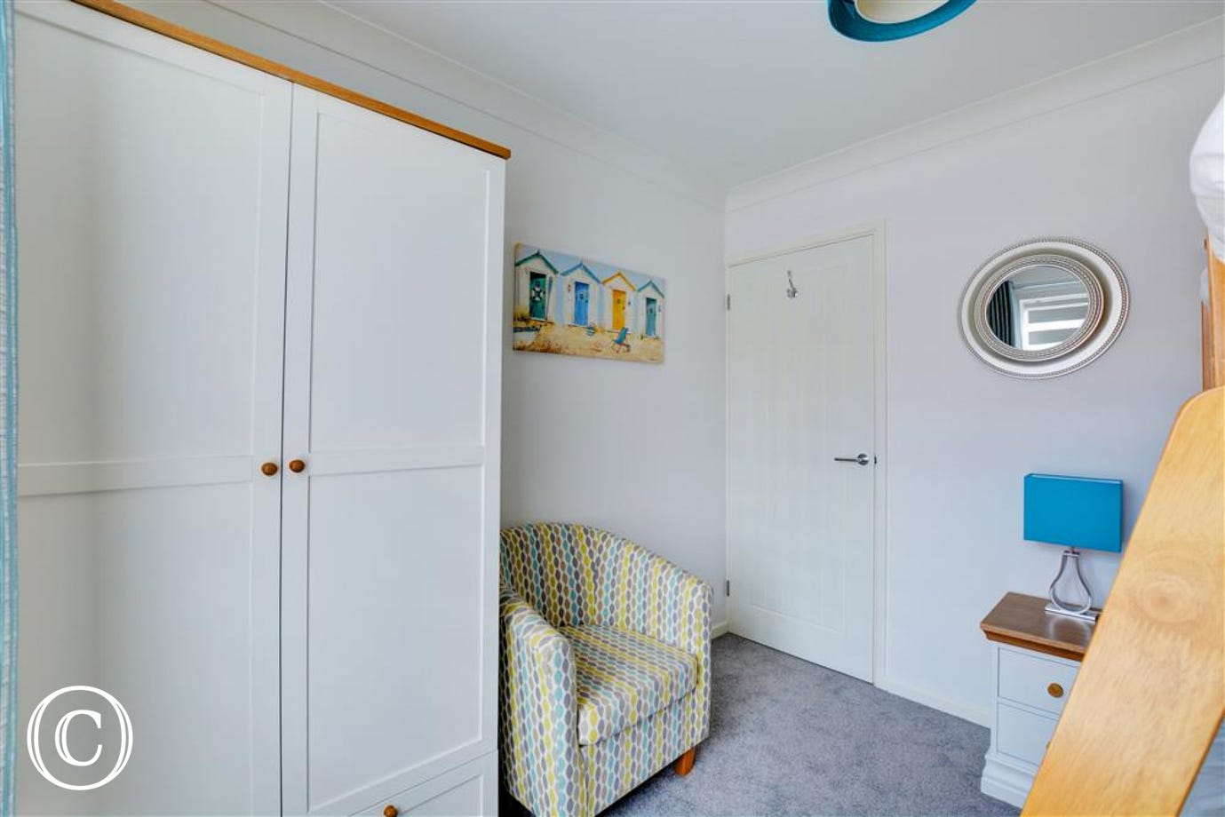 Seating and storage in the third bedroom