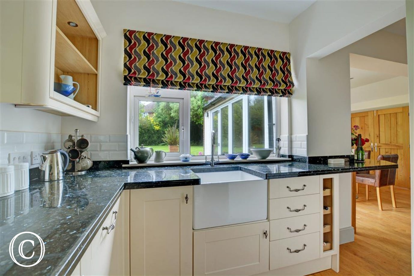 The kitchen has an electric double oven and gas hob