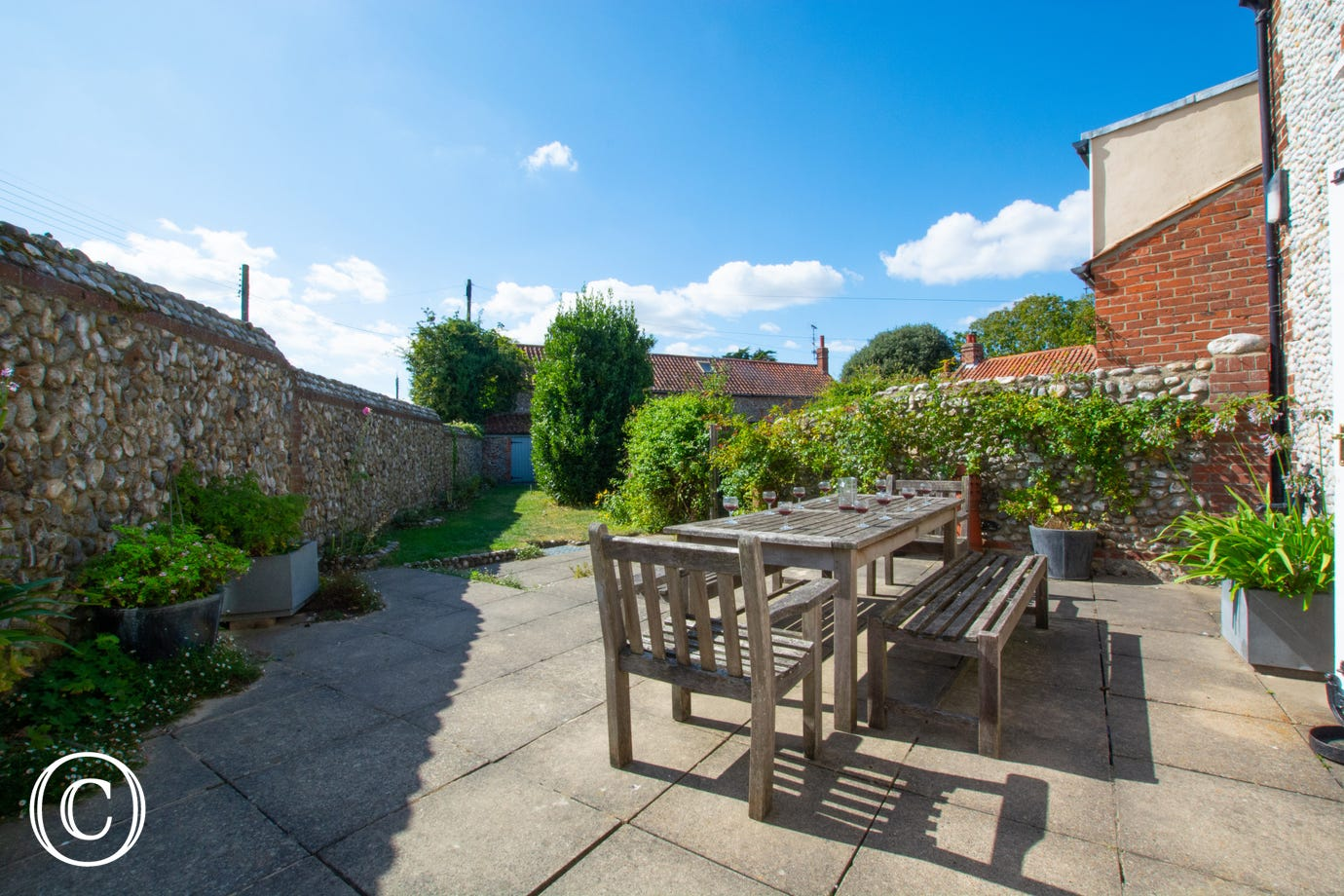 Enclosed rear garden with patio, garden furniture and a barbecue for al fresco dining
