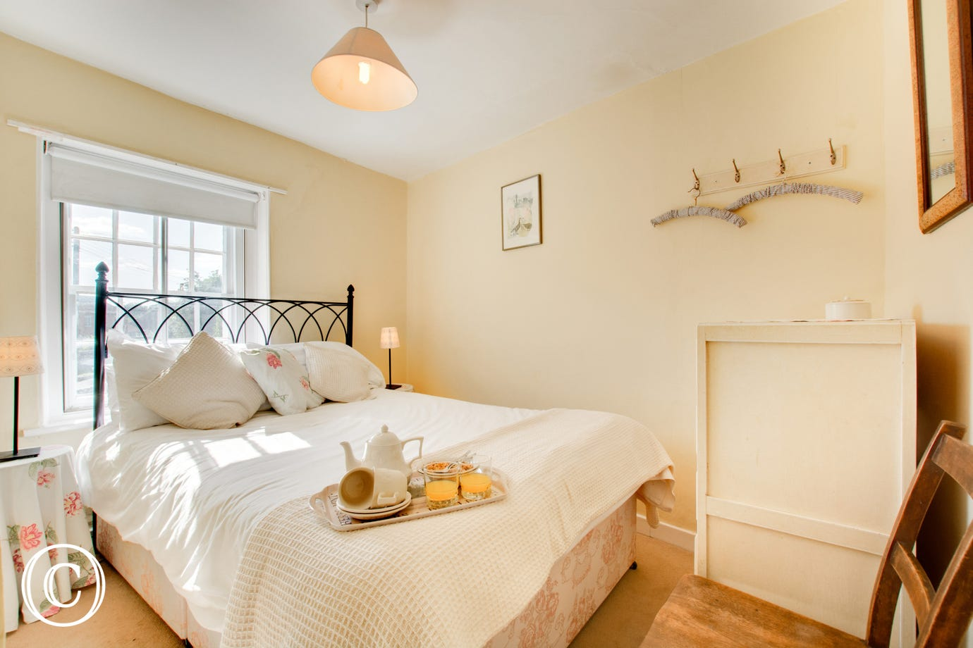 Pretty compact double bedroom with a wrought iron double bed