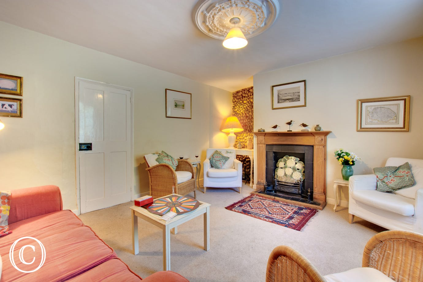 Traditional sitting room with comfortable seating and a woodburner for cosy evenings