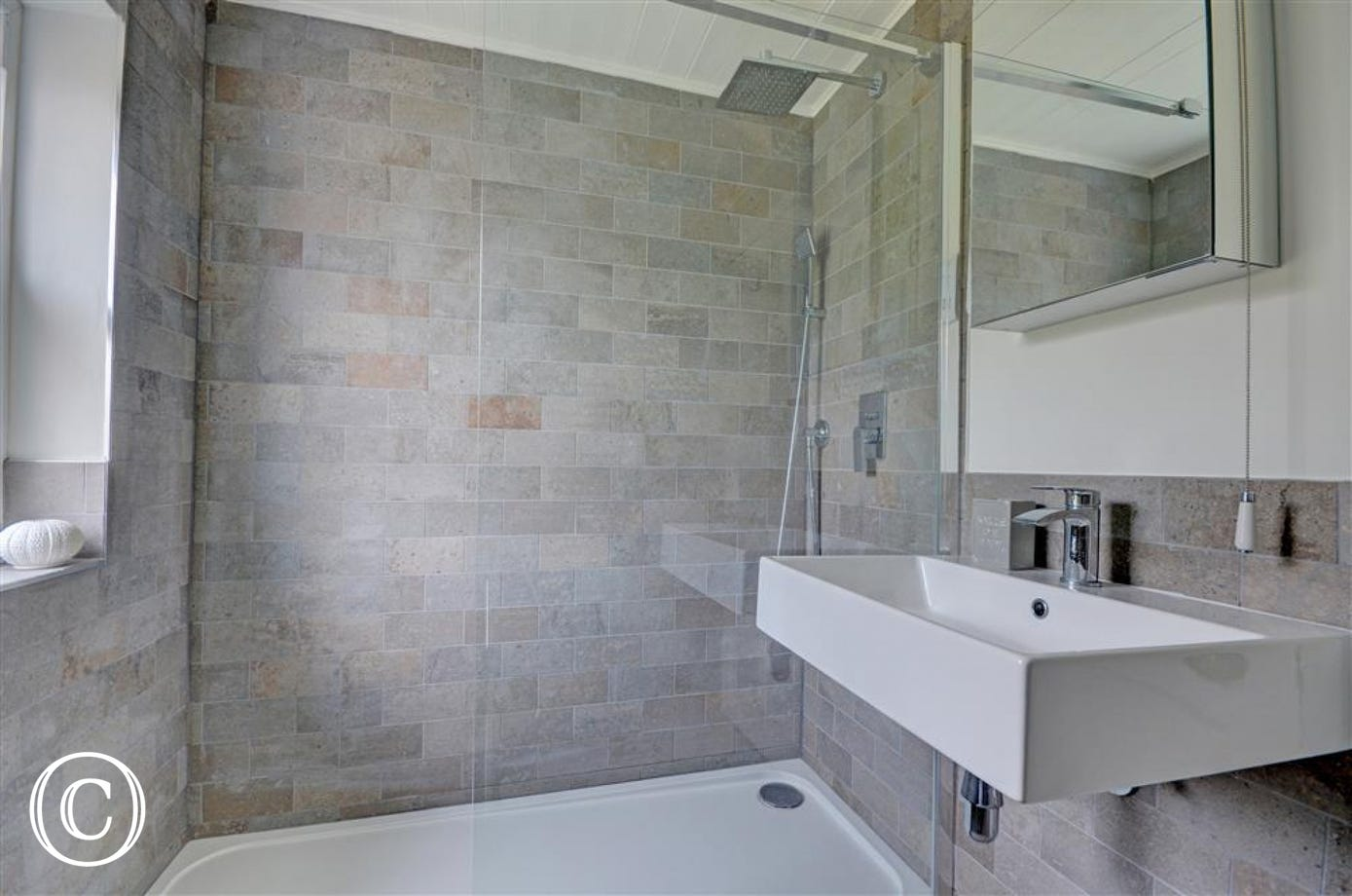 Tiled shower room with large shower cubicle