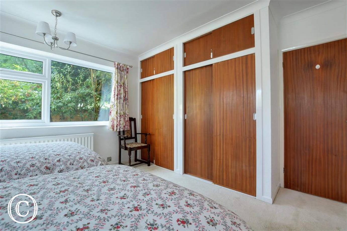 Built in wardrobes provide ample storage in the main bedroom