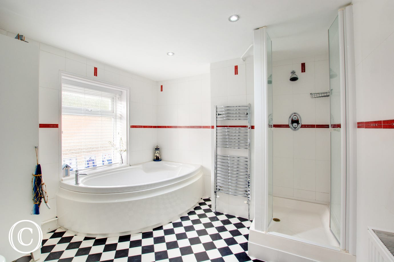 Bathroom with corner bath and shower cubicle