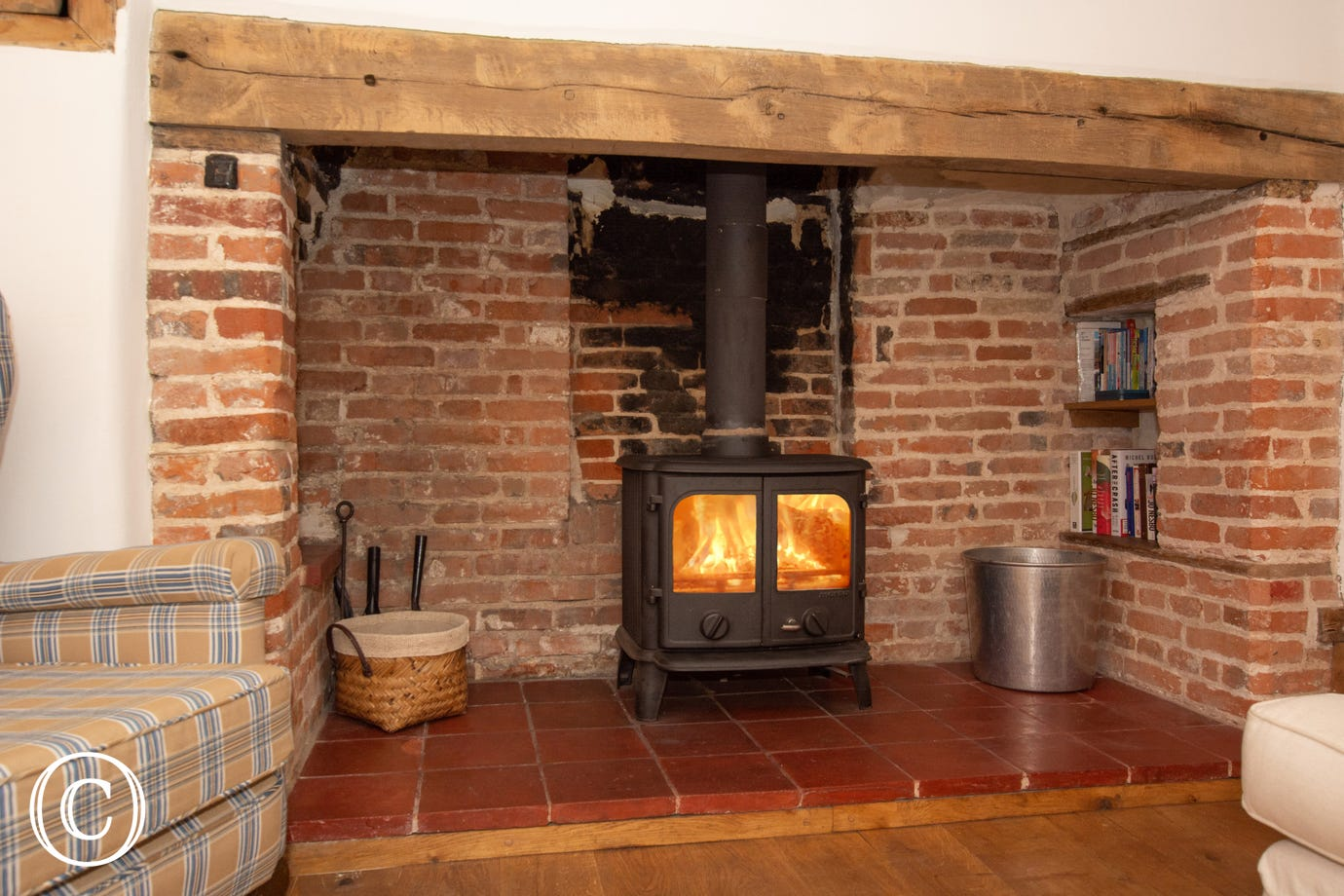 Inglenook fireplace with woodburner