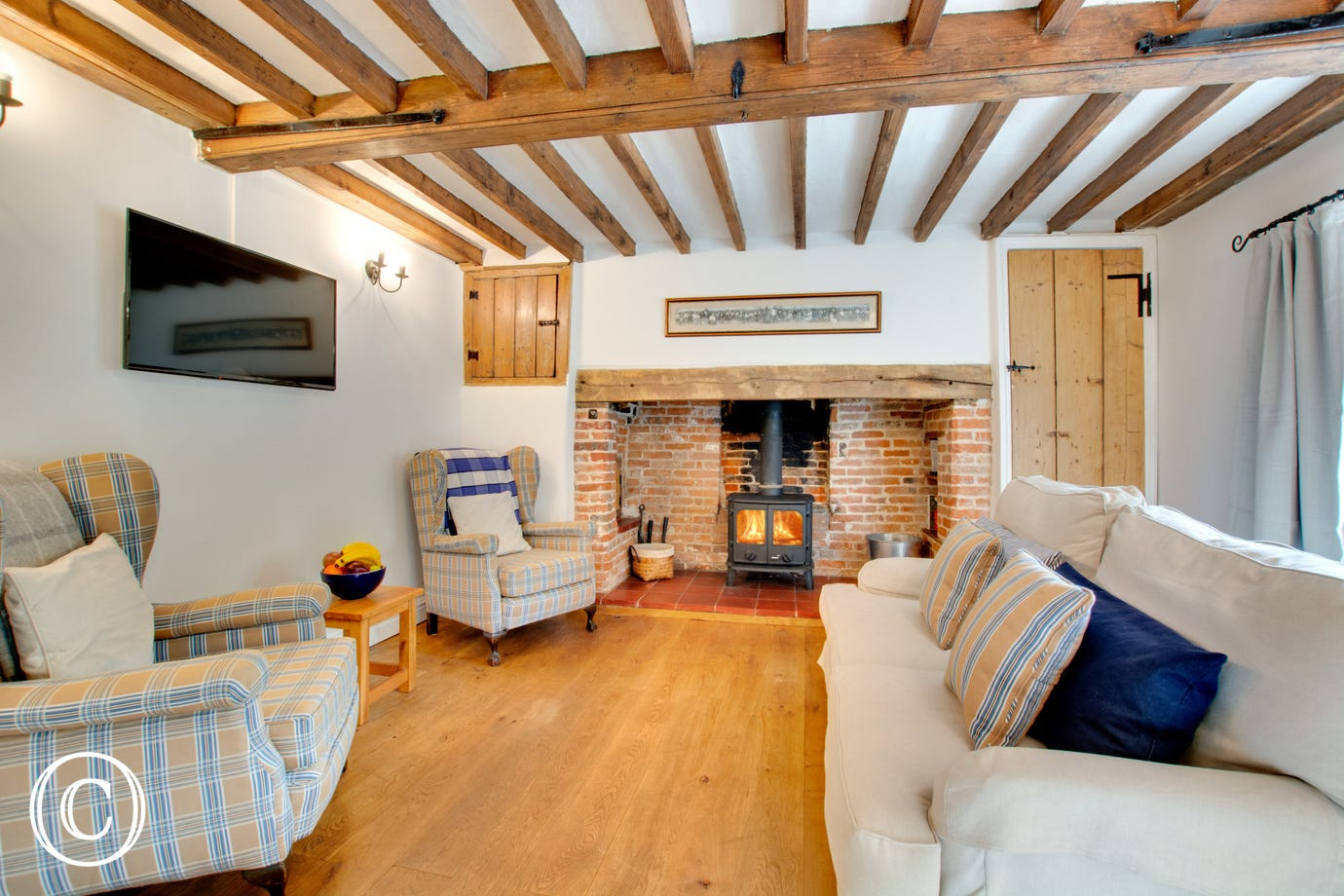 Sitting Room with woodburner, TV & comfortable seating
