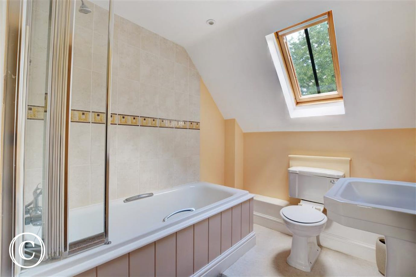Family bathroom with bath and overbath shower