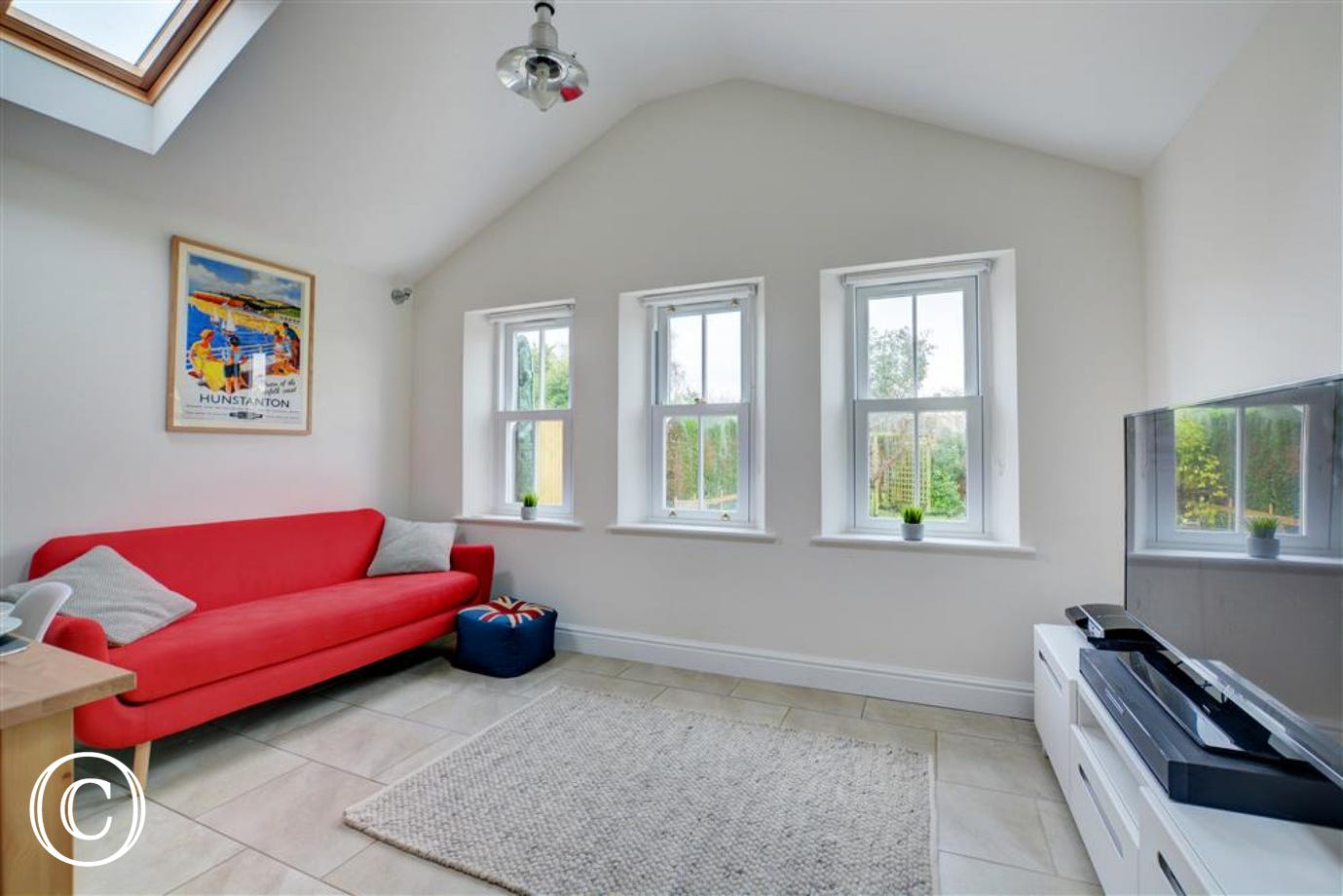 The sitting area is very light and airy with plenty of comfortable seating making it perfect for families