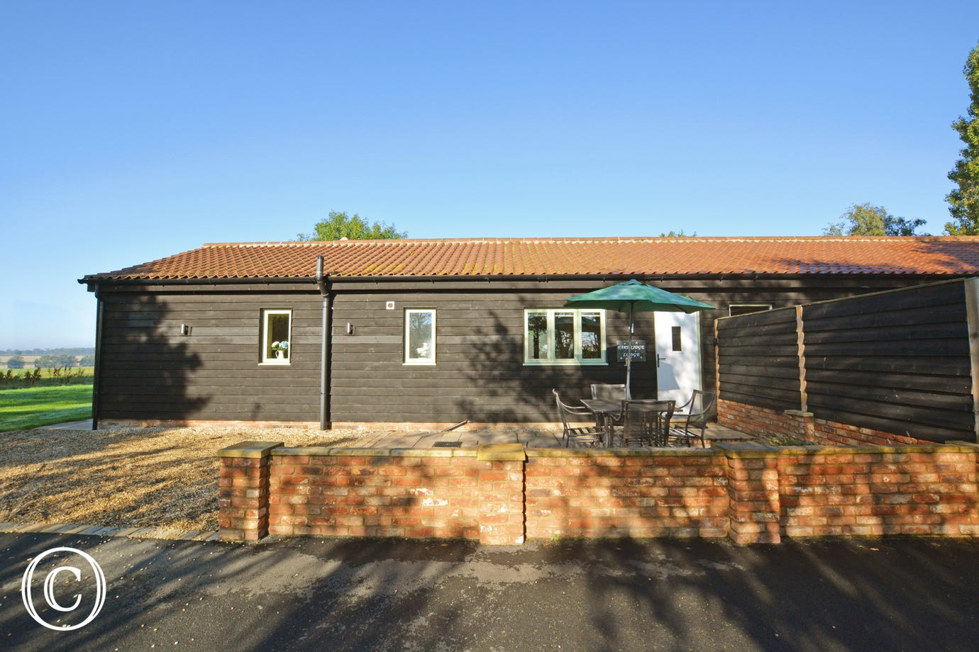 Exterior image of this lovely single storey lodge