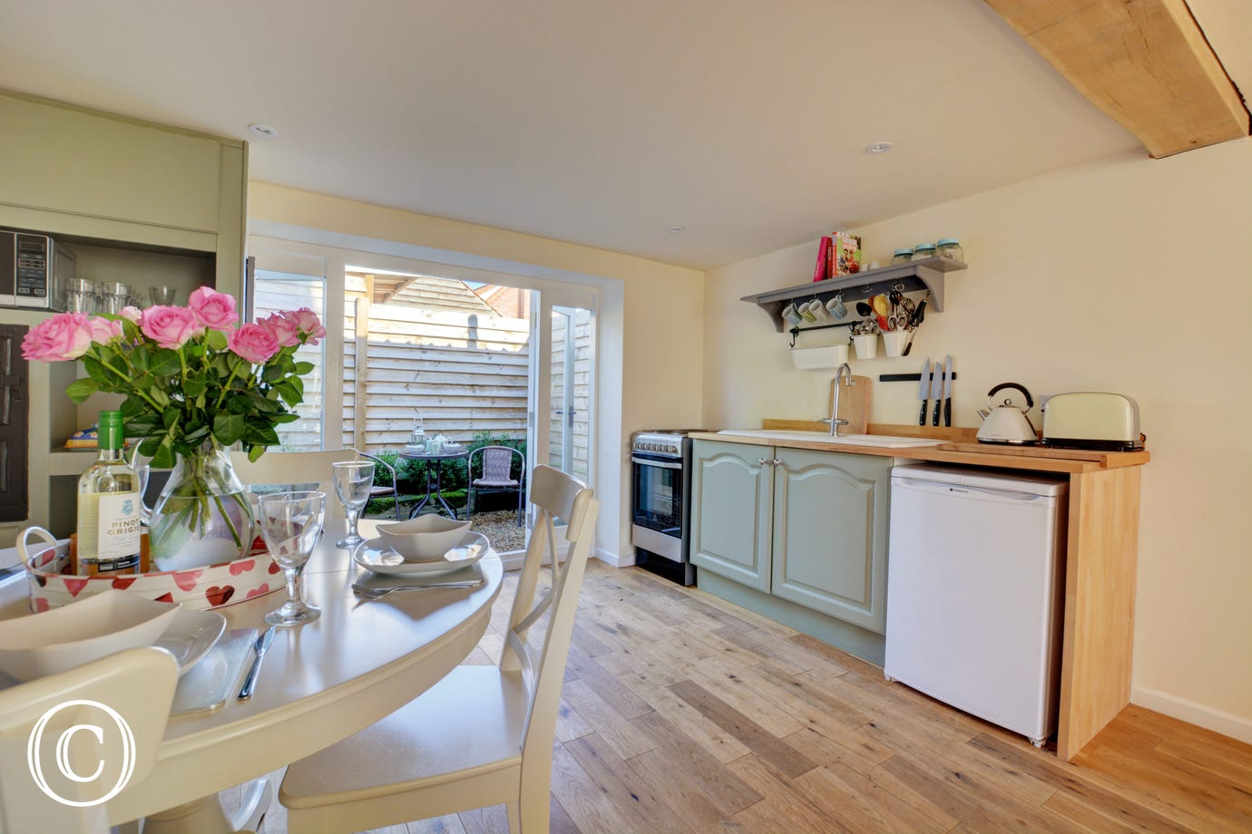 Pretty Kitchen and Dining area with door to outside seating area