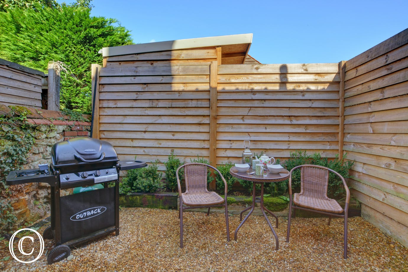 Shingled Garden with seating and barbecue