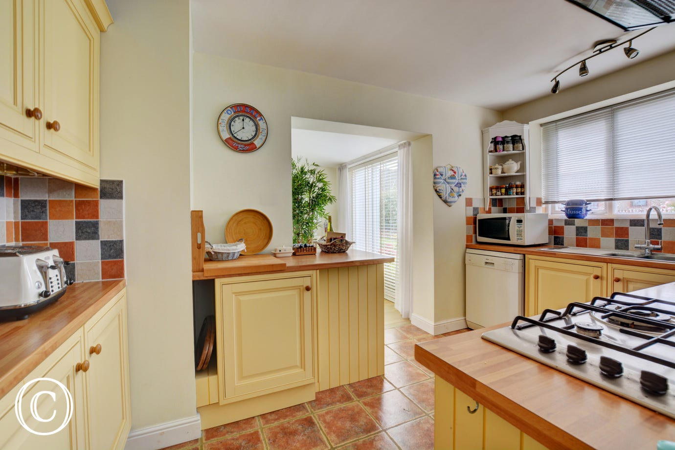 Kitchen with  with built in electric oven, gas hob, freestanding American fridge freezer, dishwasher, microwave and drinks fridge
