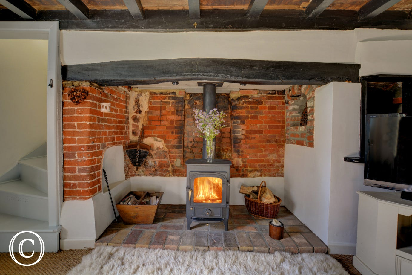 Woodburner in the Sitting Room - perfect for warming your toes on a cold winters day