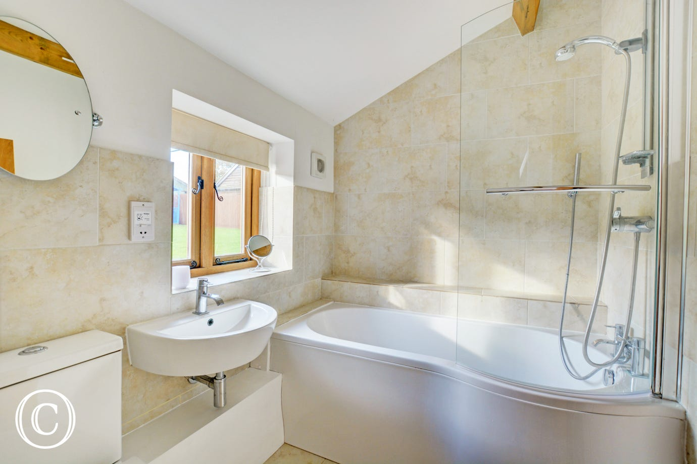 En-Suite to Bedroom 1 with bath with shower over, washbasin and wc