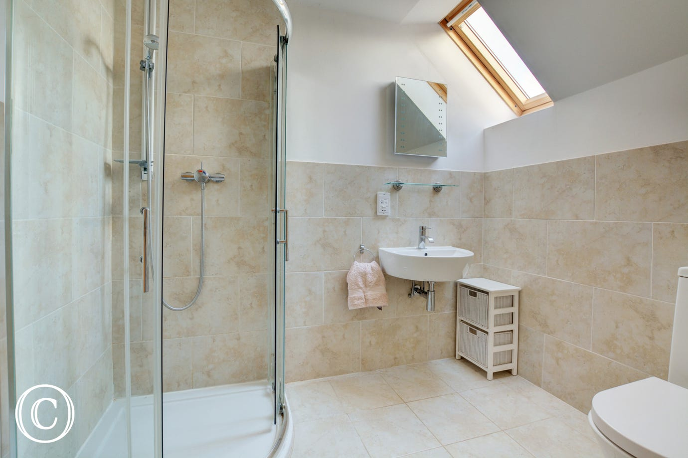 En-Suite to bedroom 2 with shower cubicle, washbasin and wc