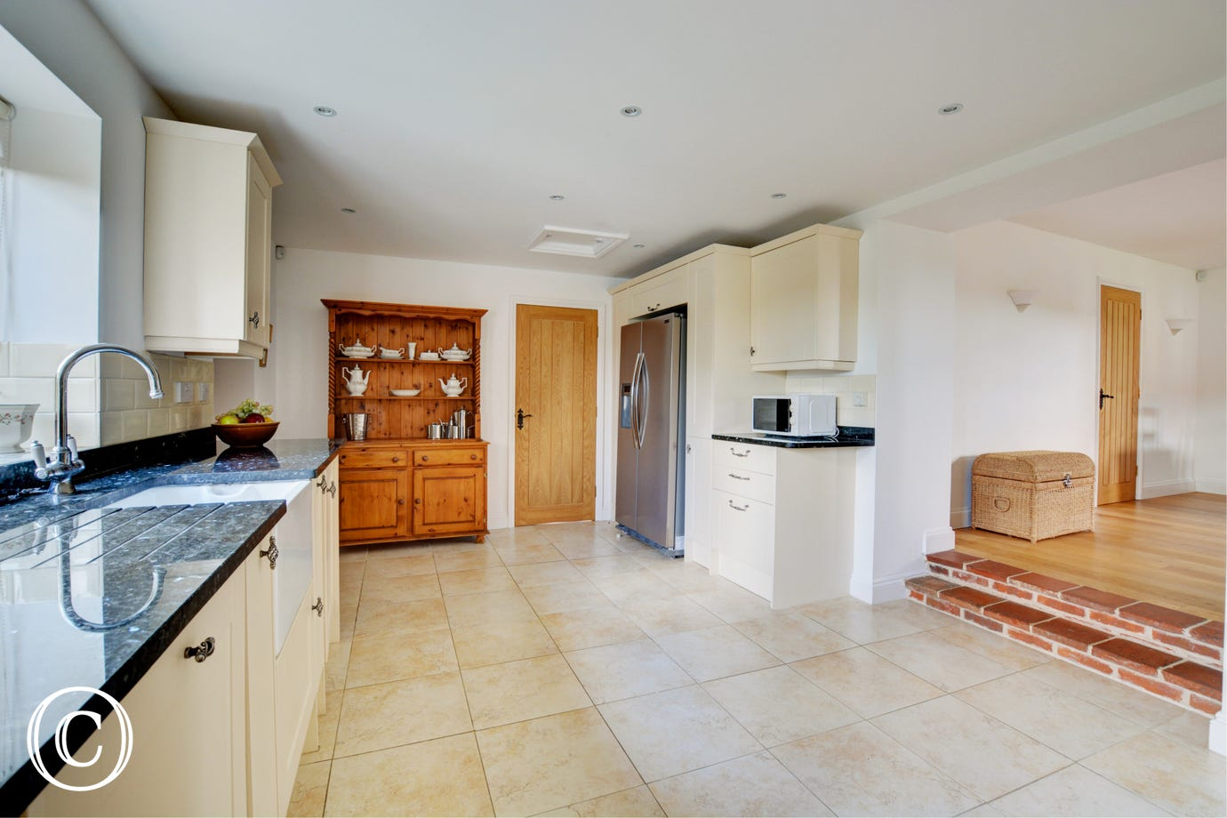 Fitted and equipped kitchen with step up to dining area