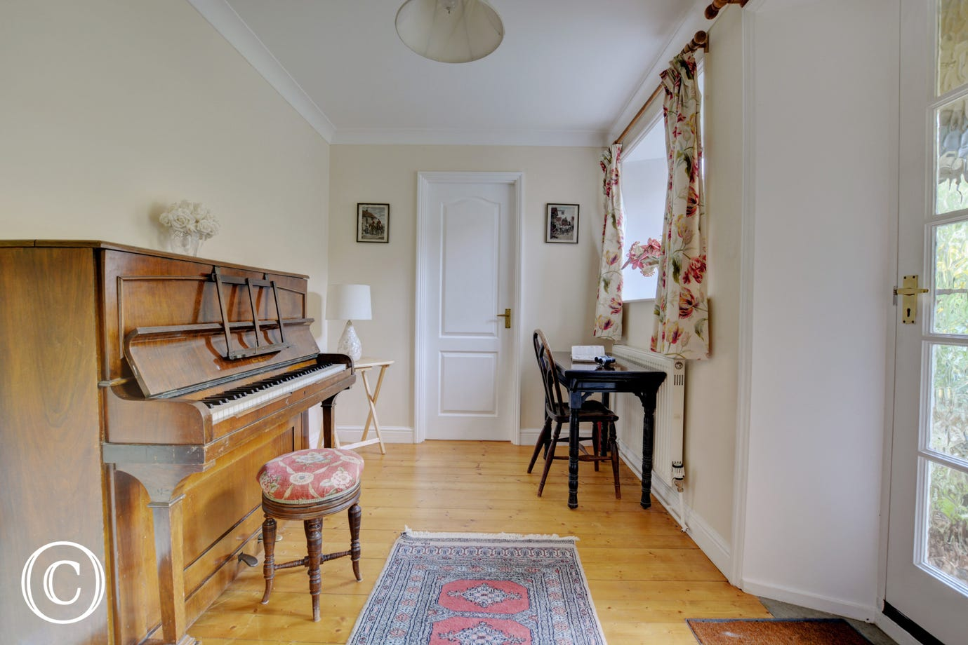 Music room with upright piano.