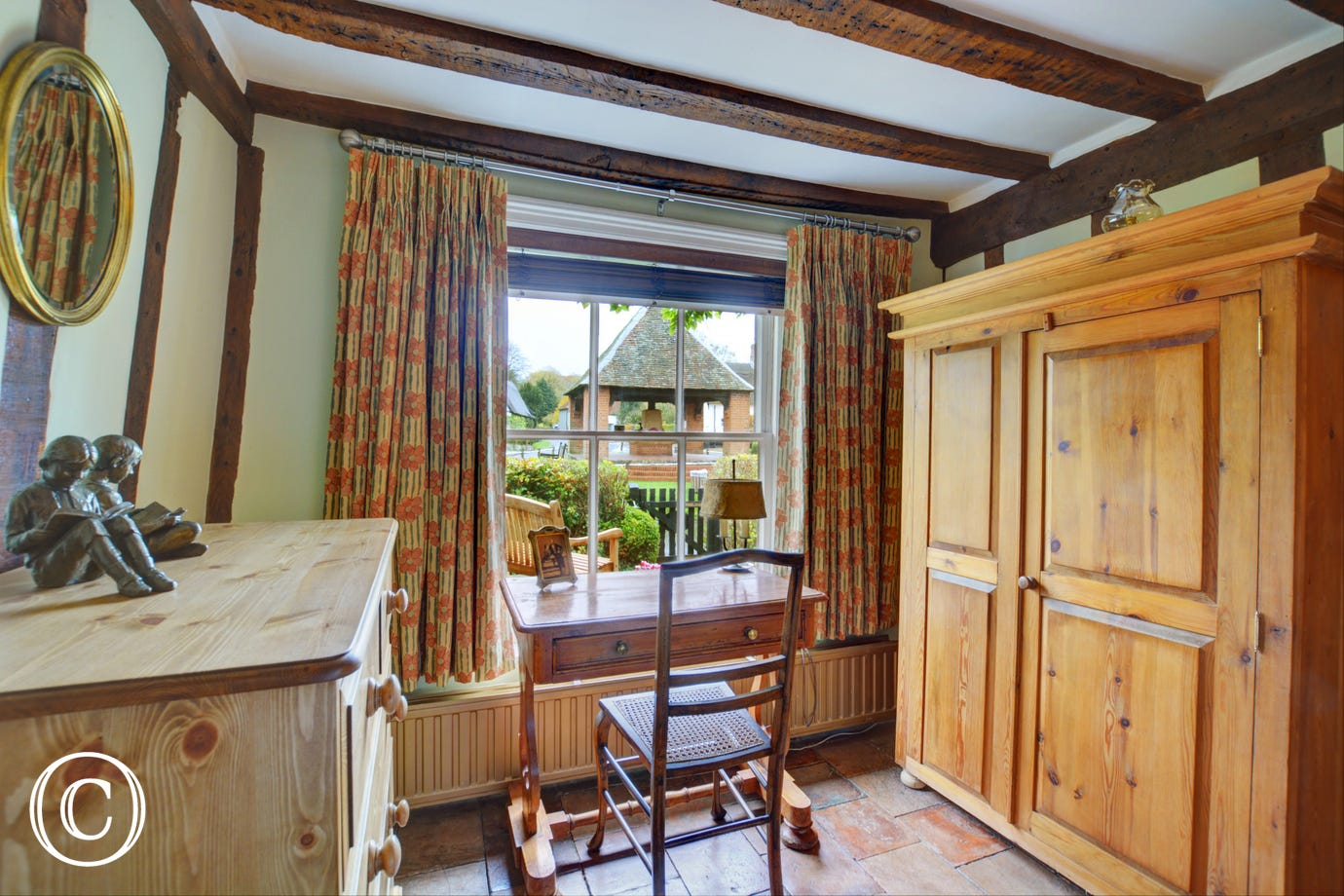 Bedroom 1 has a wardrobe, chest of drawers and a desk next to the window - perhaps a good spot to write a postcard or two