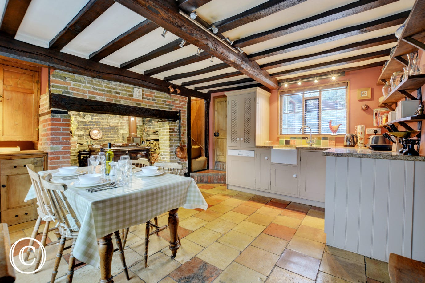 Spacious Kitchen with dining table and chairs and lots of character  - a lovely place to sit and enjoy a meal