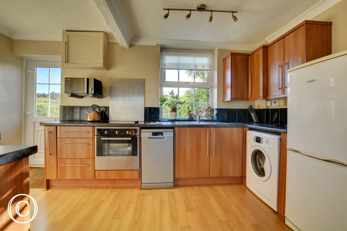 Well equipped kitchen with electric oven