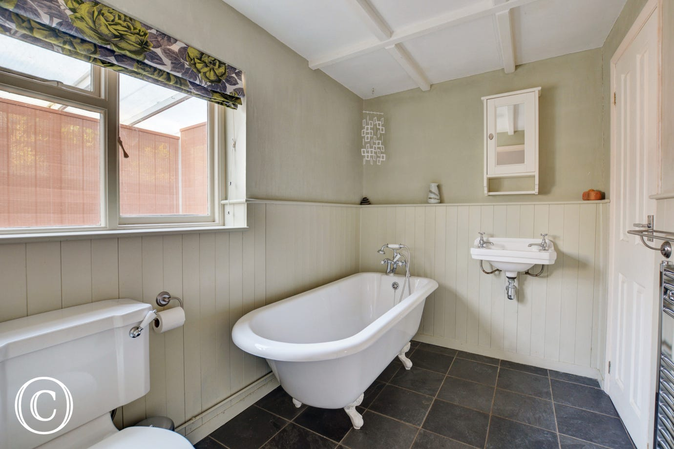 Bathroom with roll top bath, washbasin and wc