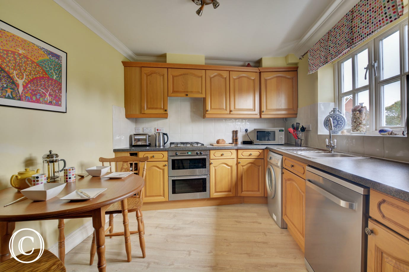 Fitted kitchen with gas hob, electric oven, fridge/freezer, microwave, dishwasher and washing machine