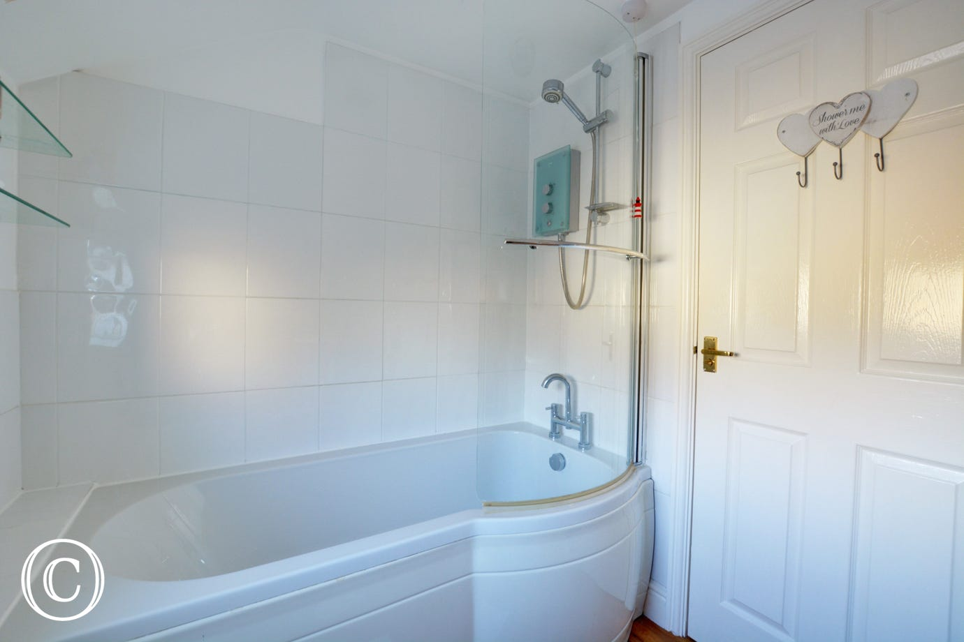 Bathroom with over the shower bath, washbasin and wc
