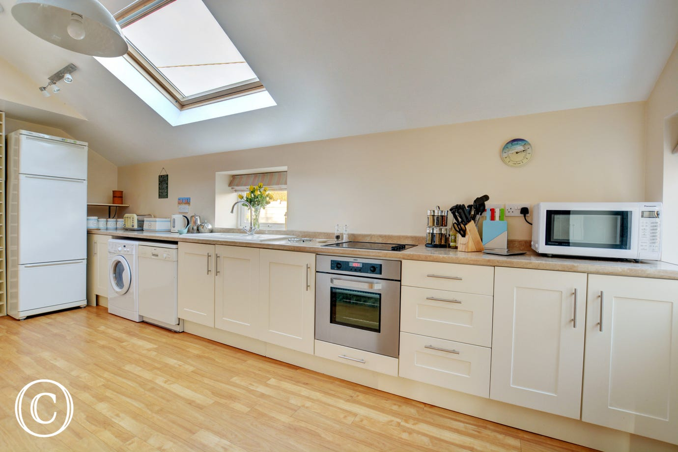 Light and airy fitted and equipped kitchen