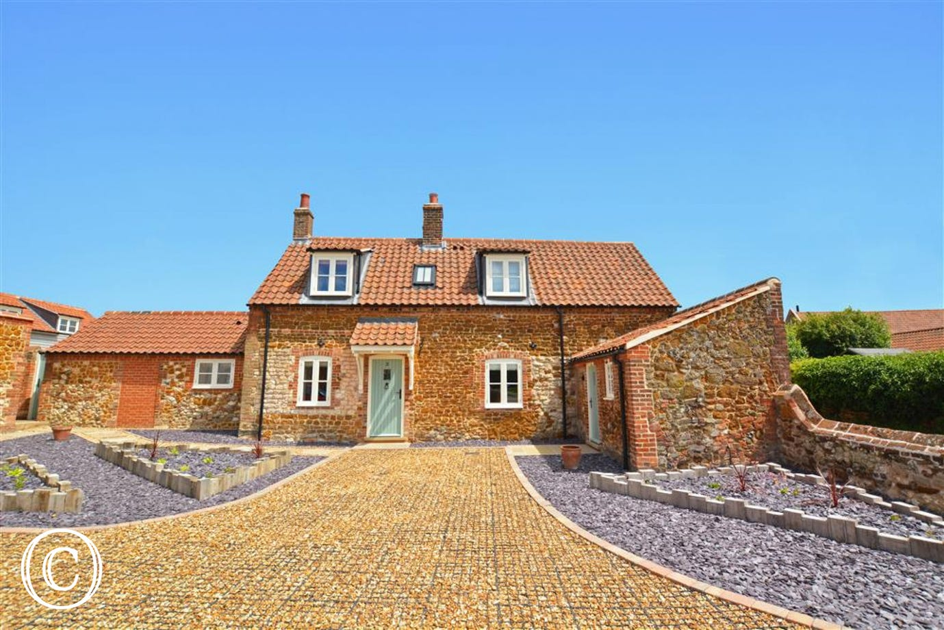 Exterior image of this traditional carrstone cottage