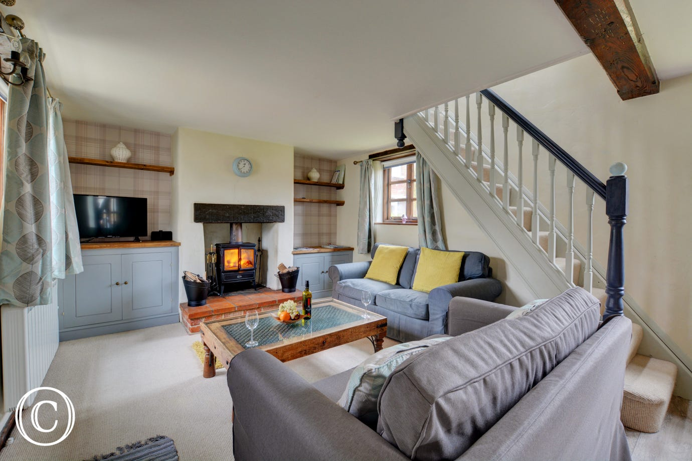 Cosy Sitting Room with comfortable seating and wood burner - perfect to warm your toes on a chilly day