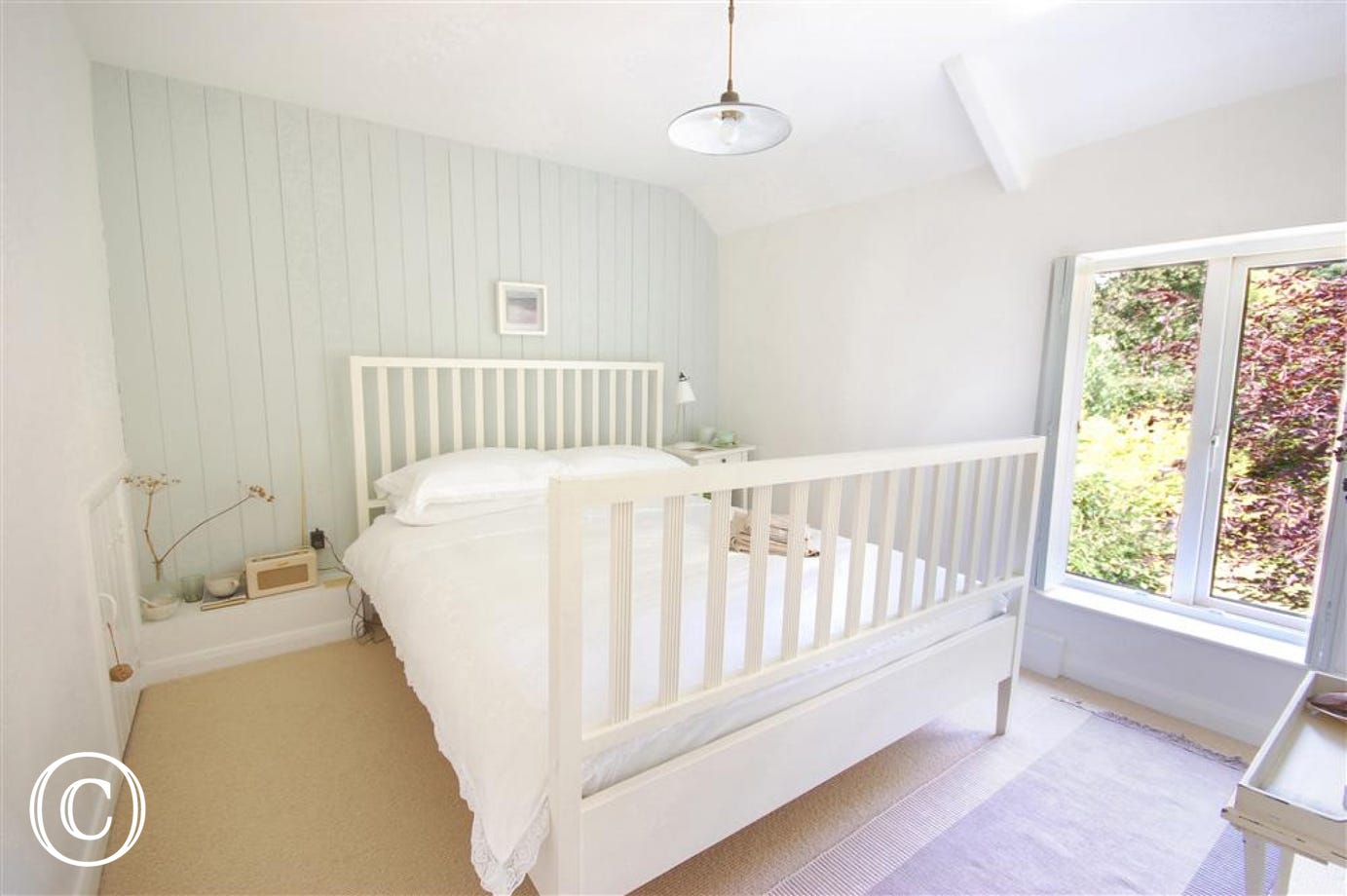 Charming, light double bedroom with a double bed and lovely views of the garden