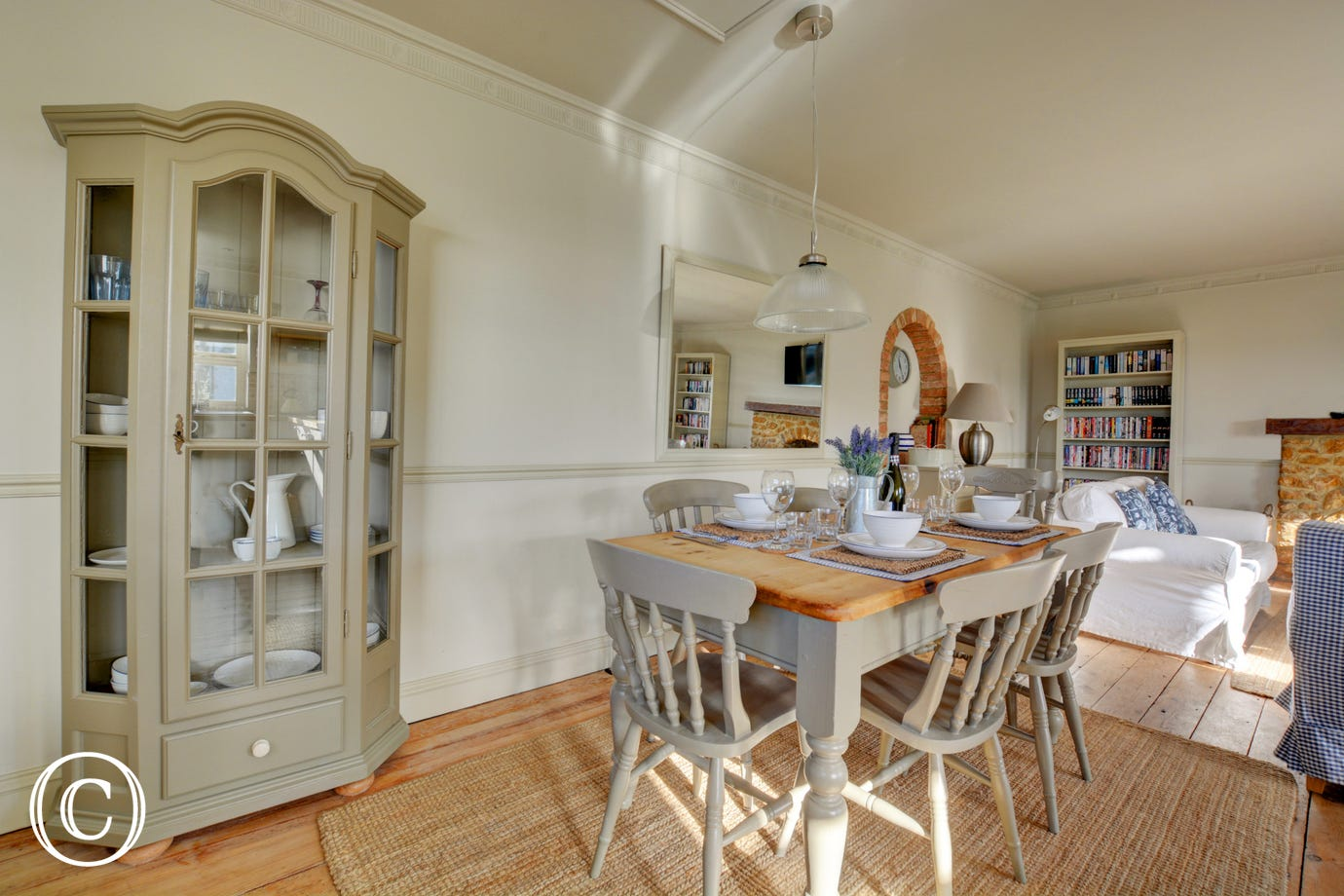 Dining Area with table and chairs - the perfect spot to make holiday plans over breakfast