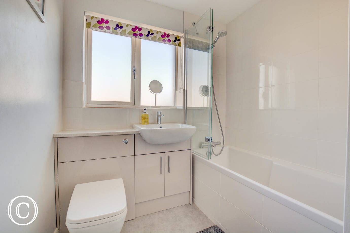 Bathroom with overhead shower on bath