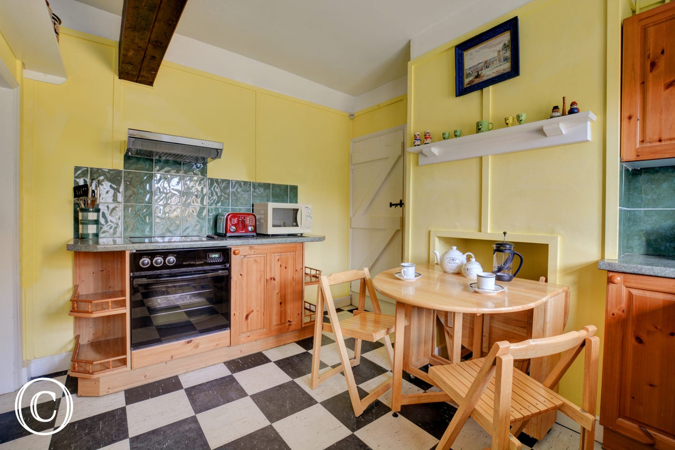 Bright kitchen/dining area with a foldaway table and chairs for family meals