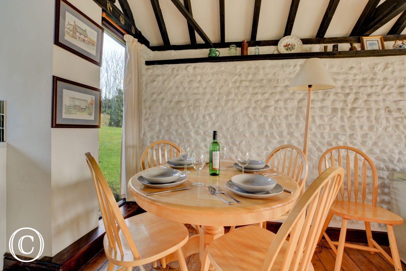 A dining area provides a table and chairs, perfect for family meals
