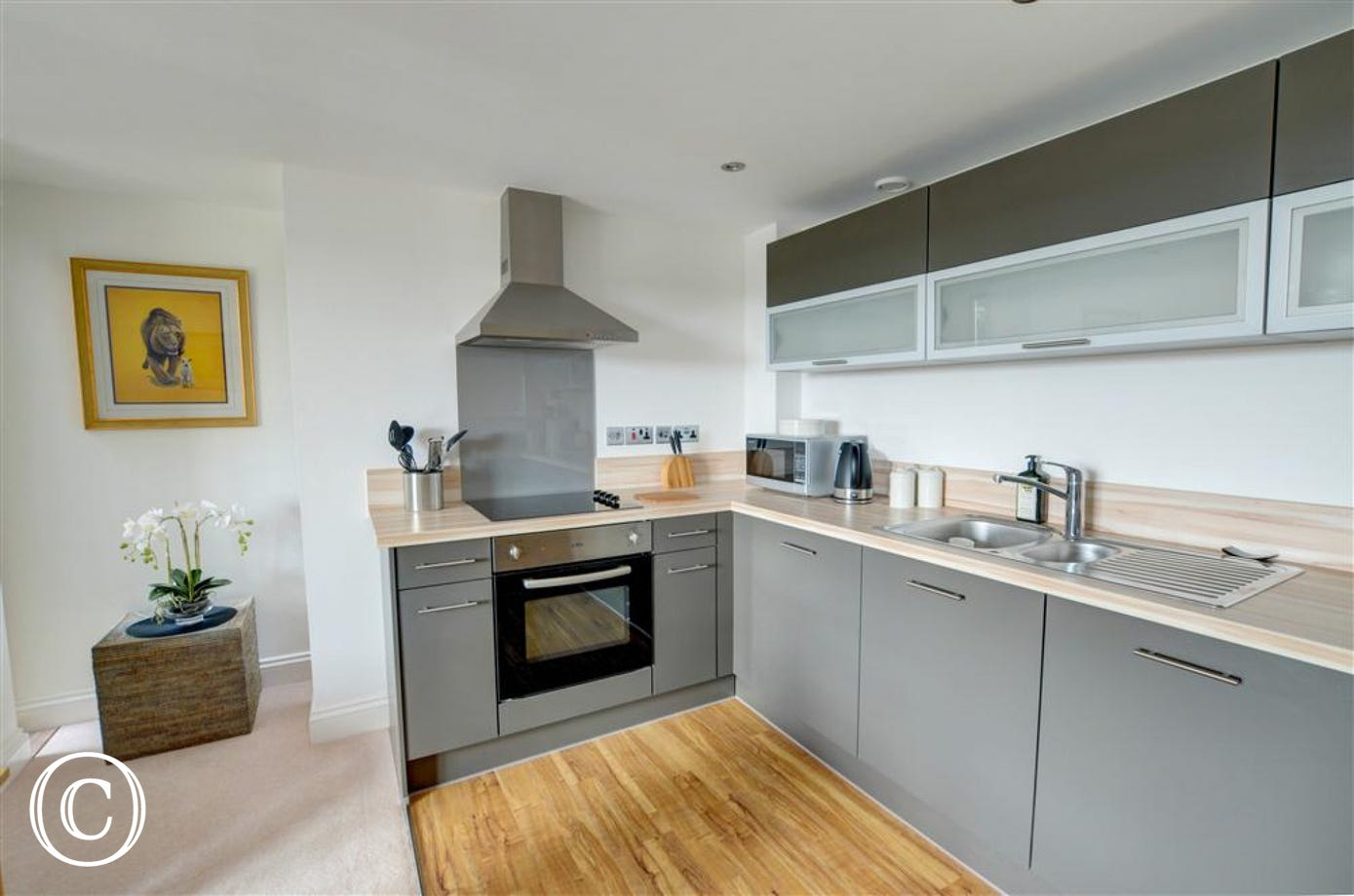 With high quality modern units, the kitchen is open plan
