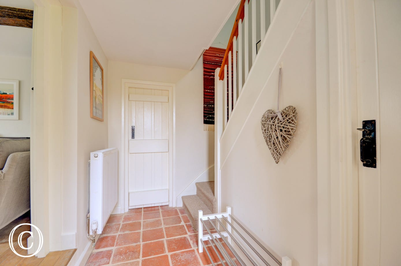 Hallway with tiled floor and stairs