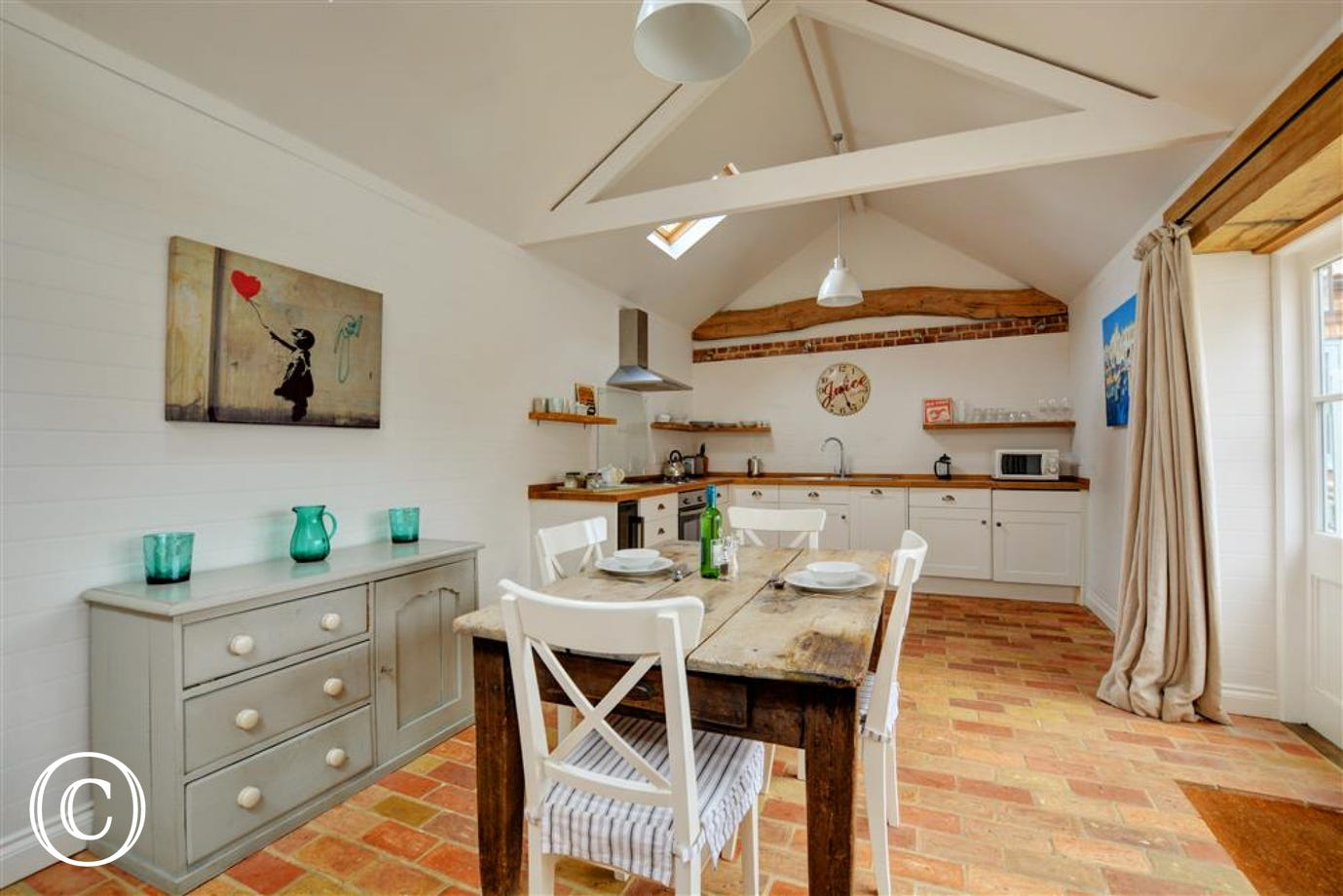 Kitchen and Dinng Area with electric built-in oven and hob, fridge with icebox, dishwasher, microwave, wine cooler fridge, washing machine and tumble dryer