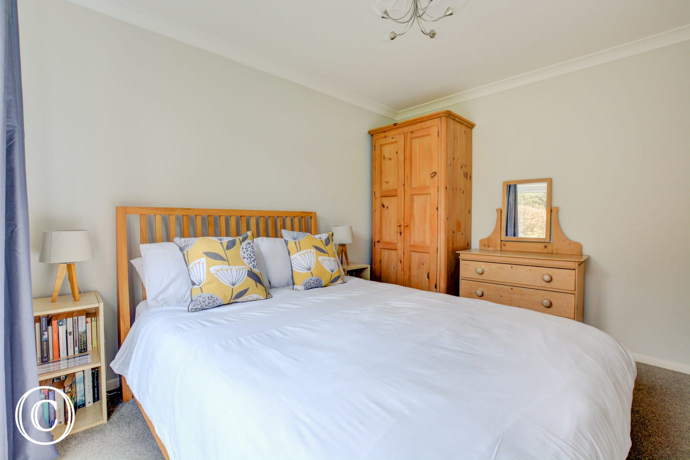 Double bedroom with double bed, wardrobe and chest of drawers
