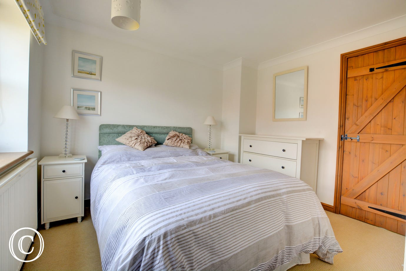 Bedroom 1 with double bed and bedside tables